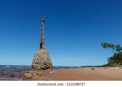 Old Kurmraga lighthouse on Baltic sea coast