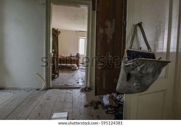 old ladies bag hanging on door in house
