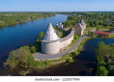 The Old Ladoga fortress on the background of the Volkhov River on a sunny summer day. Old Ladoga, Russia