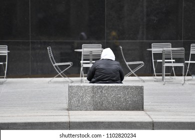 An old lady is begging for money in downtown Toronto-Canada