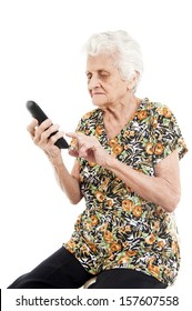 Old lady dialing someone on white background .
