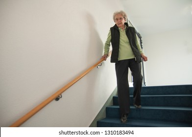 Old lady going down the stairs