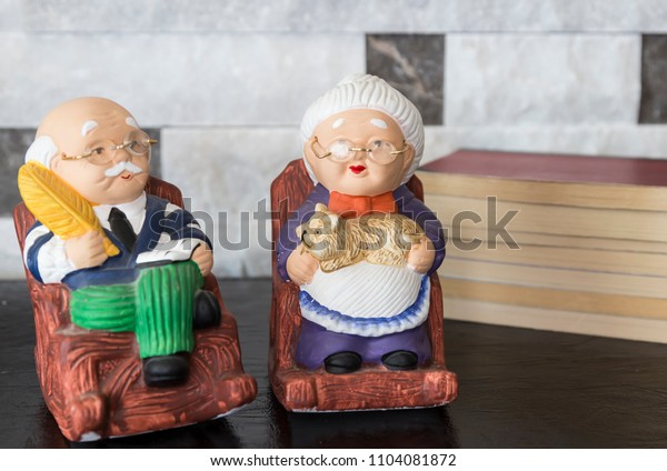 old lady and man figurine