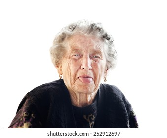 old lady puts out her tongue  on an isolated background