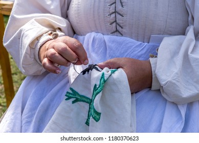 Old lady sewing outdoor - handmade traditional