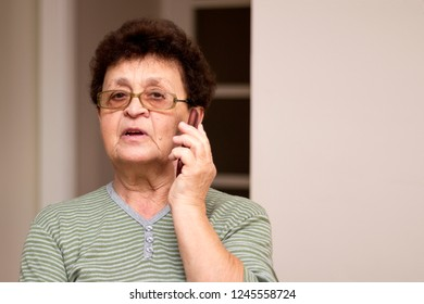 Old lady using mobile phone.Portrait of an elderly woman,