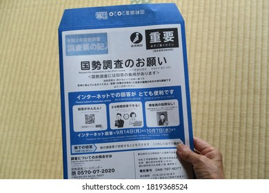 "An old lady's hand and questionnaires for Japan Census 2020 (国勢調査 kokusei chousa) distributed. The envelope says ""Please answer the census."" Kasukabe, Saitama, Japan, September 22, 2020."