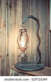 Old lamp in a mine. Burning kerosene lamp in dark, concept lighting.