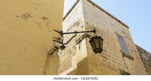 Old Lamp with Modern CCTV Camera, Mdina Malta Summer 2018 horizontal photography