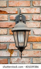 old lamp on brick wall - Shutterstock ID 401039386