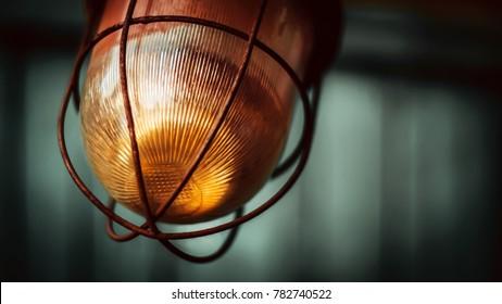 Old lamp. Orange glass. Metal rim.