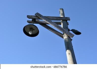 Old lamp post in blue sky