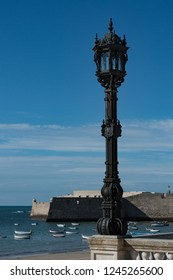 Old lamppost looking to the sea