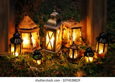 Old lamps with lights in the garden at night. Fabulous decor for the holiday