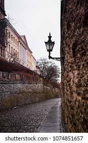 An old lantern above a medieval alley in the old town of Tallinn, the capital of Estonia. These lanterns are very typical in the area.