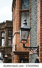 old lantern , brick wall - Shutterstock ID 576329041