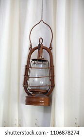 Old lantern on a light background