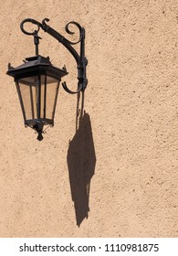 Old lantern on the wall of the building