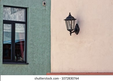 An old lantern in a renovated wall of an old building in Tallinn, Estonia. The buildings are being renovated fast in the capital of Estonia, but people are keeping the beautiful old details like this.