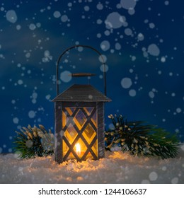 Old lantern in the snow at night