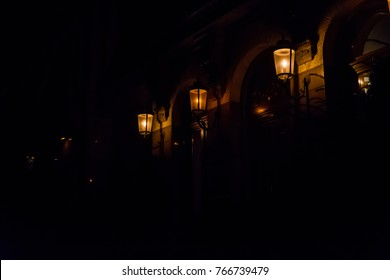 Old lanterns on a wall of house
