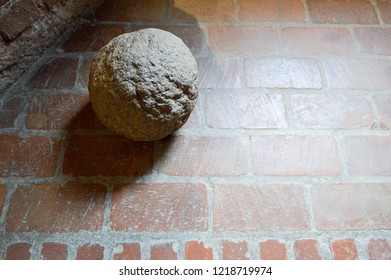 Old large stone ancient medieval iron martial round spherical cannonball.