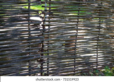 Old lath fence made of willow rods. Natural background.