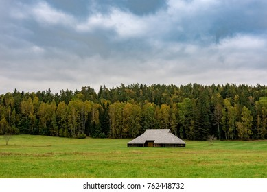 Old Latvian wooden barn in the field