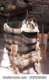 Old laundry room with a wooden barrel for a wringer washer