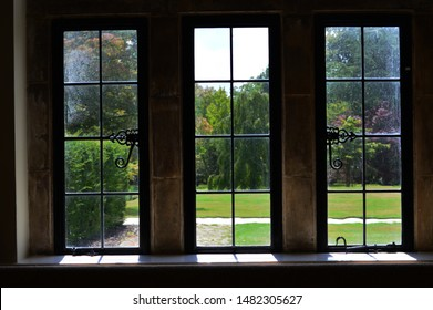 Old lead lined windows in stone frames