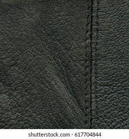 old  leather background decorated with a seam