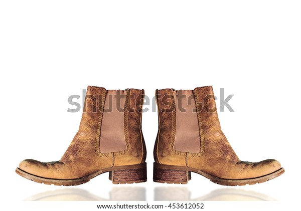 Old leather boots on a white background.