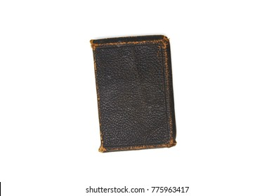 An old leather bound book on white background.