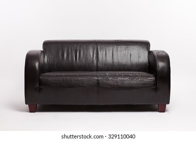 old leather couch on a white background