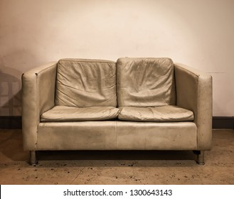 An old leather sofa in sepia tones