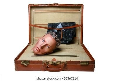 an old leather suitcase with a plaster mannequin head from the 1930s inside