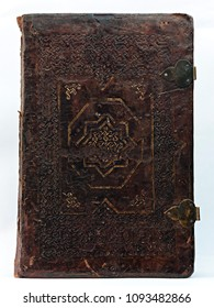 Old leather-bound book (detail of the gilded cover).