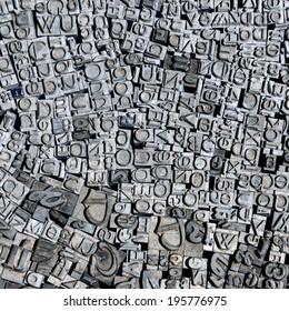 Old letterpress German letters from a flea market, background, square composition