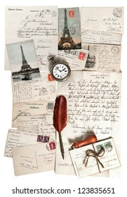 old letters, accessories and post cards. sentimental vintage background with antique clock and feather pen