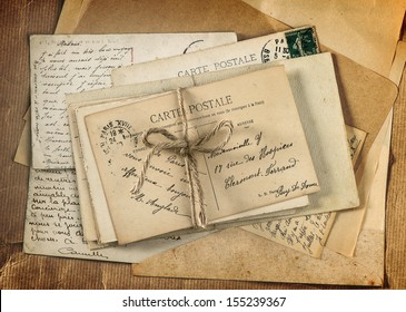 old letters and antique french postcards. vintage sentimental background retro style
