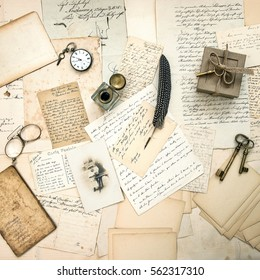 Old letters and postcards, vintage accessory and antique photo of a child. Retro nostalgic background