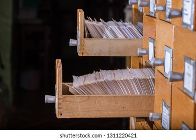 Old library or archive reference catalogue with  opened card drawer. Database and knowledge catalog concept