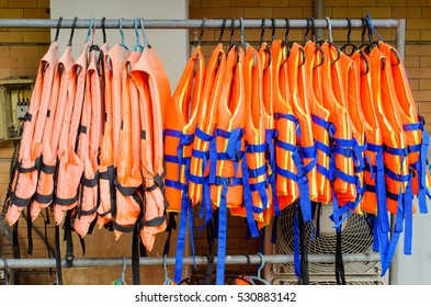 Old life jackets and new its hanging on the row