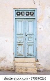 old light blue door with steps in Tunisia