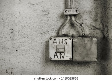 """old light switch with the inscription """"on, off"""" in an abandoned factory in Magdeburg"""