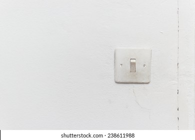 old light switch on the white wall