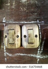 old light switch on wood wall
