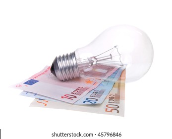 old lightbulb and money. waste of energy