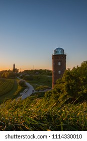 The old Lighthouse Cape Arkona in Ruegen island. Sunset at the Baltic Sea