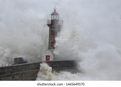 Old lighthouse embraced by stormy waves. North of Portugal.